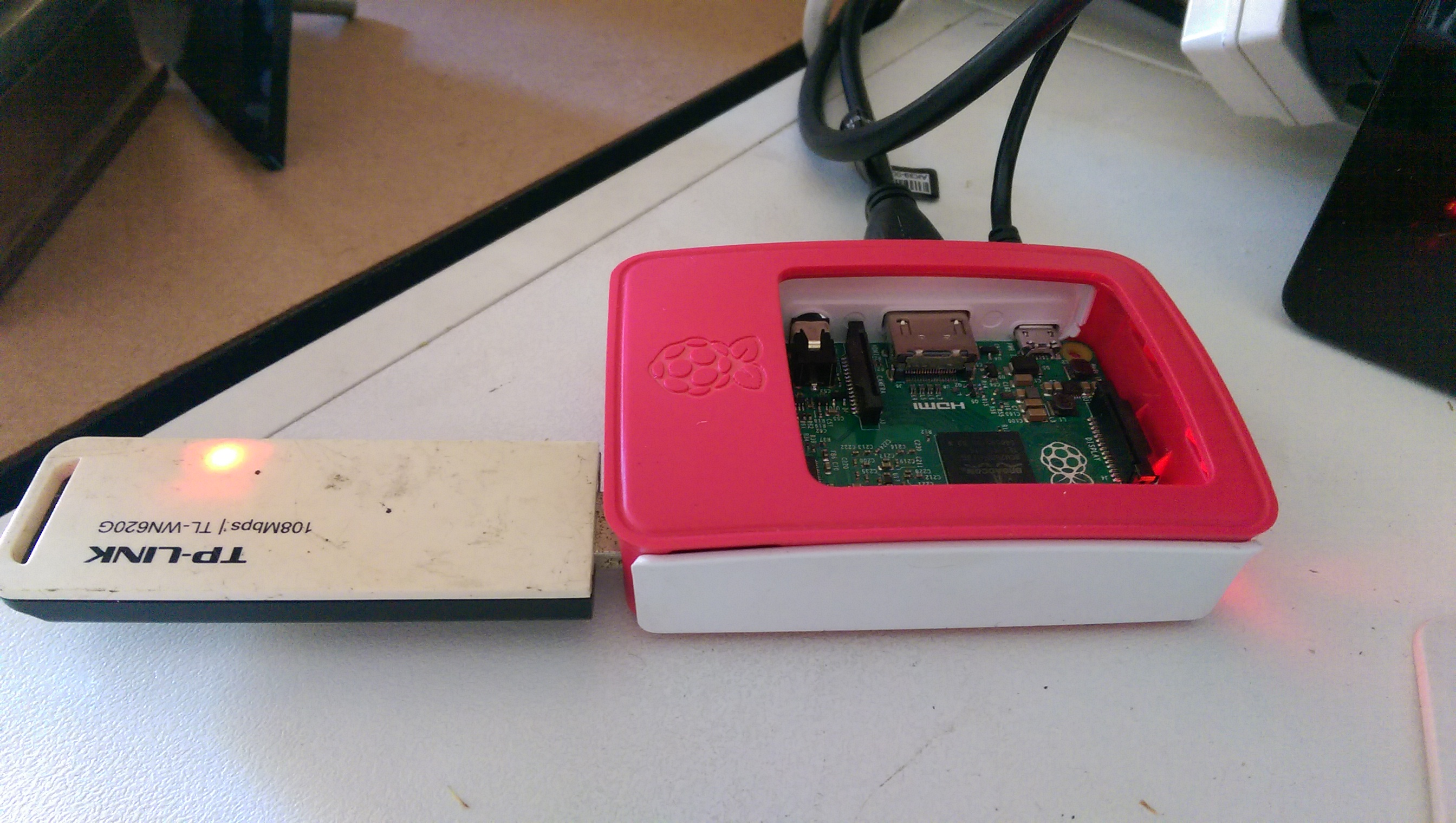 Raspberry Pi Model B, in the offical case and an USB Wireless LAN stick